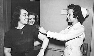 US Office of War Information employees receive free inoculations against smallpox in 1943