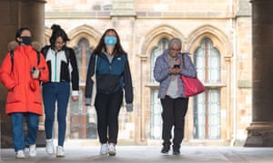 Students at Glasgow university wearing face masks as the university moves all student exams online due to the virus outbreak.