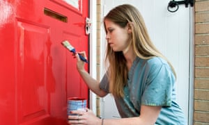 A woman painting a door
