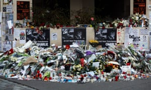 Flowers are placed near the Paris offices of magazine Charlie Hebdo in January 2015.