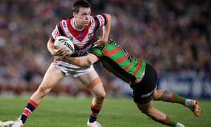 Luke Keary of the Roosters is tackled by Adam Reynolds of the Rabbitohs during the NRL preliminary final at Allianz Stadium in Sydney.