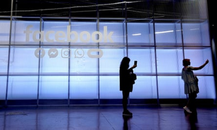 Attendees take a selfie in front of a Facebook sign at F8, Facebook's developer conference in San Jose, last year
