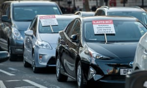 Placards are placed on cars as taxi drivers block traffic  in protest of Sadiq Khan's new congestion charge proposals in London