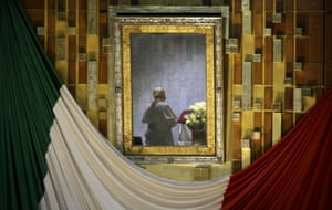 Pope Francis is photographed praying in front of the image of Our Lady of Guadalupe while celebrating mass in Mexico City