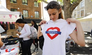 Girl looking at Grenfell T-shirt sold in aid of charity