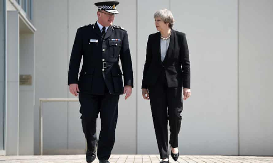 Theresa May with chief constable of Greater Manchester Police Ian Hopkins.