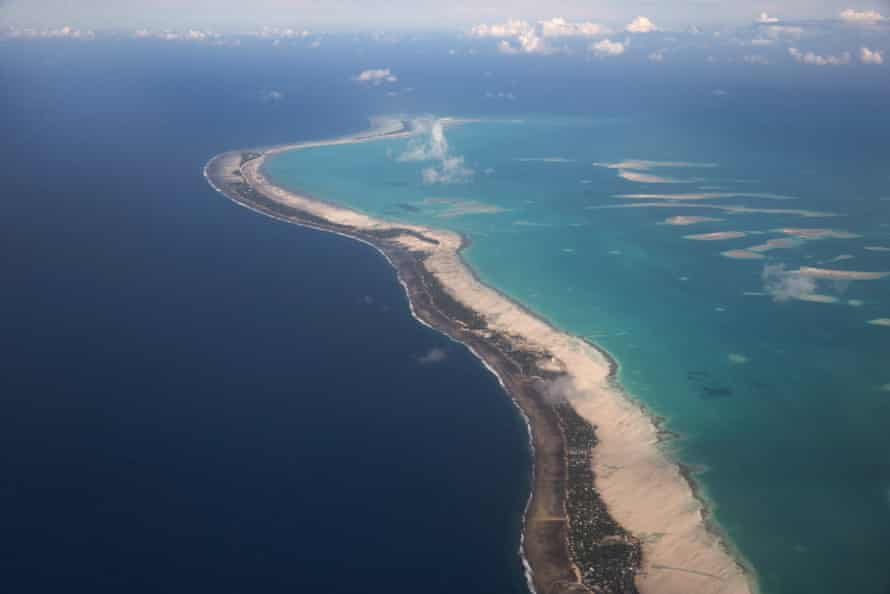 The island of South Tarawa, looking south towards the most heavily populated areas of Bairiki and Betio. The ocean side is to the left and the lagoon side is to the right.