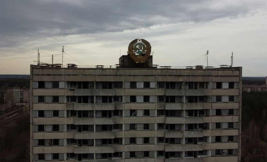 The coat of arms of the Soviet Union is seen on the roof of a building in the abandoned city of Pripyat.