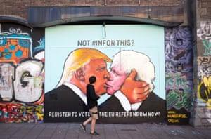 Bristol, England: A pedestrian passes a mural