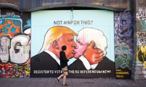 Mural of  US presidential hopeful Donald Trump sharing a kiss with former London Mayor Boris Johnson