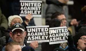 Newcastle fans hold signs reading United against Ashley