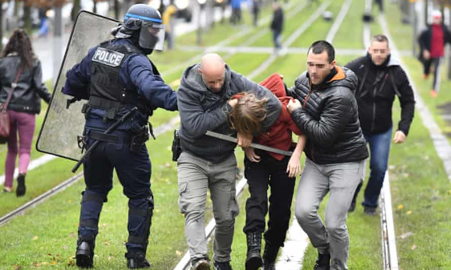 Police arrest a high school student during a demonstration in Bordeaux.