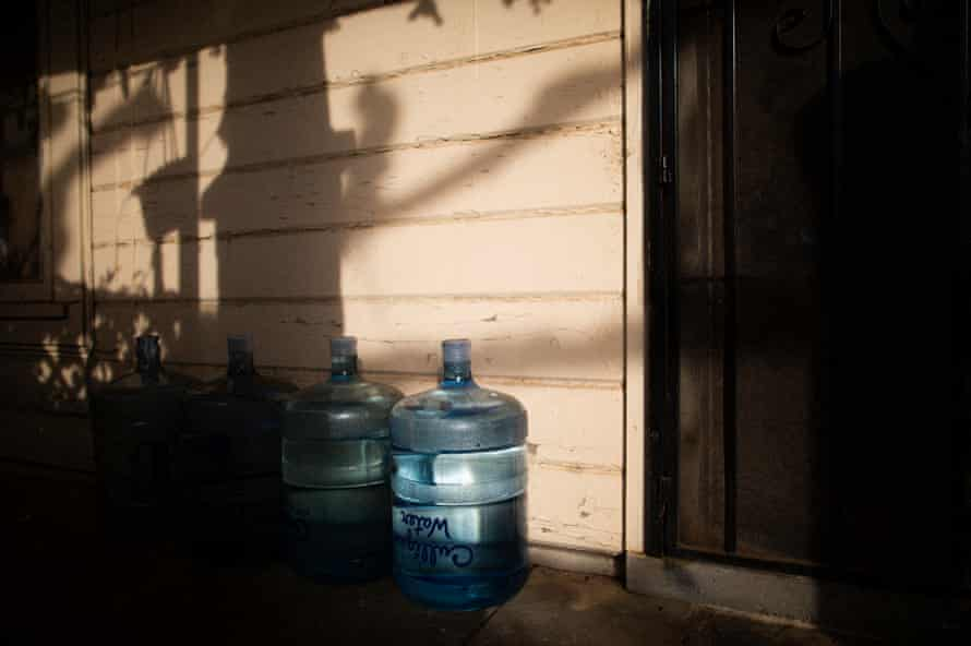 Bottled water on a front porch in Tombstone Territory, an unincorporated working class neighborhood south-east of Fresno, California, 21 February 2020.