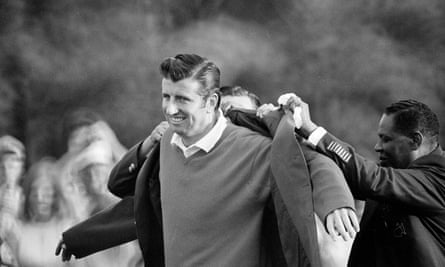George Archer is helped into the famous green jacket.