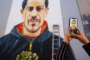 Bethlehem, West BankA woman takes a picture of a mural of Iyad Hallak, a 32-year-old autistic Palestinian man shot dead by Israeli police, painted by artist Taqi Spateen on a section of Israel's separation barrier.