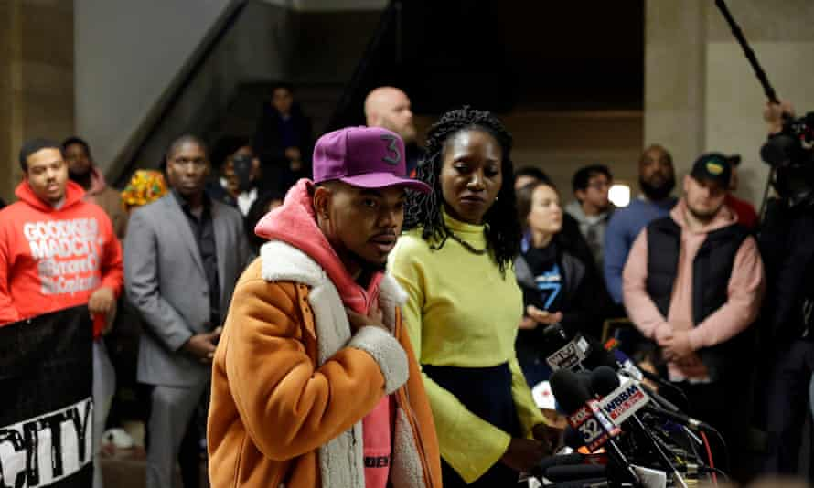 Chance the Rapper, who has endorsed Amara Enyia for mayor of Chicago, at a news conference on 16 October at City Hall as Enyia listens.