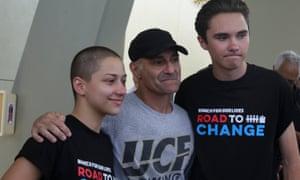 Parkland survivors-turned-activists Emma González and David Hogg stand with Mitch Dworet, father of Parkland victim Nicholas Dworet.
