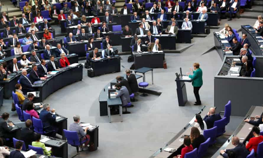 Angela Merkel addresses the Bundestag in Berlin