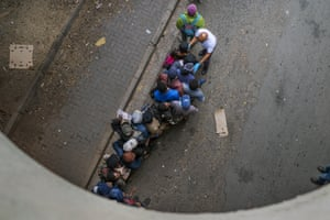 Homeless people queue to receive food baskets from private donors, on 13 April, in Johannesburg.