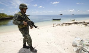 Filipino soldier patrols shore of Pag-asa island