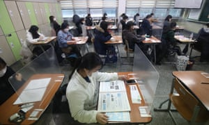 South Korean students take their College Scholastic Ability Test at a school in Seoul, South Korea.