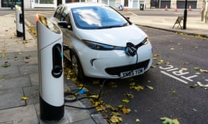 White Renault Zoe Dynamique NAV electric car charging at kerbside charging point