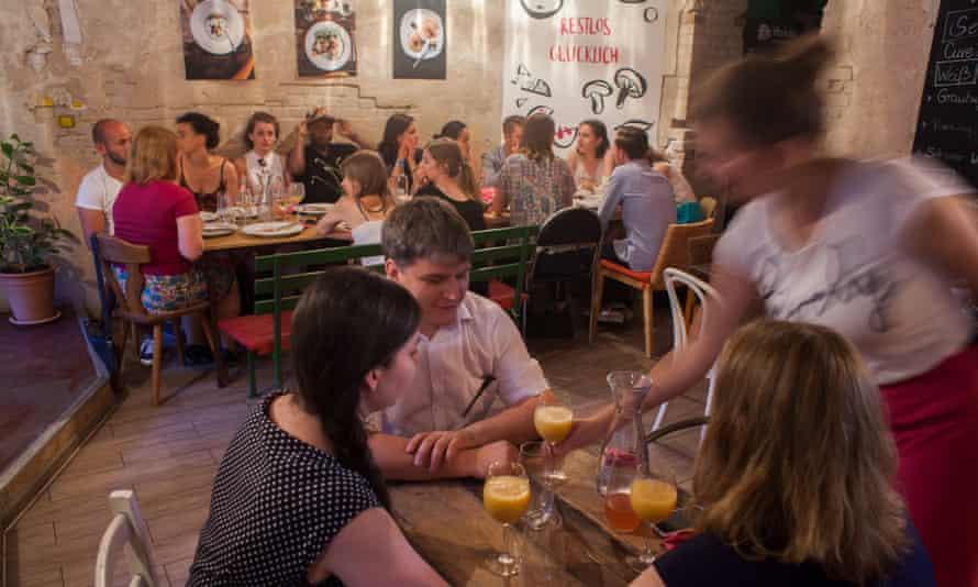 happy diners at Restlos Glücklich, Berlin.