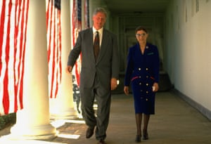 President Bill Clinton strolling the White House colonnade with Ginsburg.