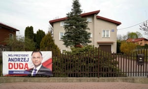 A campaign poster for Andrzej Duda outside a house near Warsaw