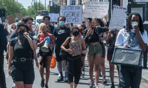 Protesters hold a rally in Brixton, south London, before marching towards central London to demand justice for George Floyd and an end to police racism in the UK and US.