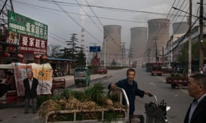 Vendors near a state-owned coal-fired power plant in China.