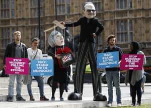Campaigners from the community-based organisation Avaaz, with a character depicting Rupert Murdoch pulling the strings of Theresa May.