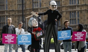 Avaaz campaigners protest against the proposed Sky deal outside parliament in London during the summer.