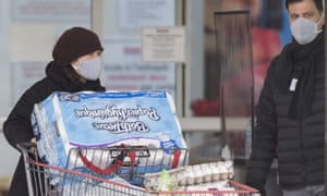 A woman wearing a mask leaves a Costco store in Montreal last month.