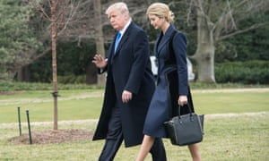 The president and his daughter walk on White House grounds. Ethics concerns have been raised about Ivanka's new position and the promotion of her brand, in which she retains a financial stake.