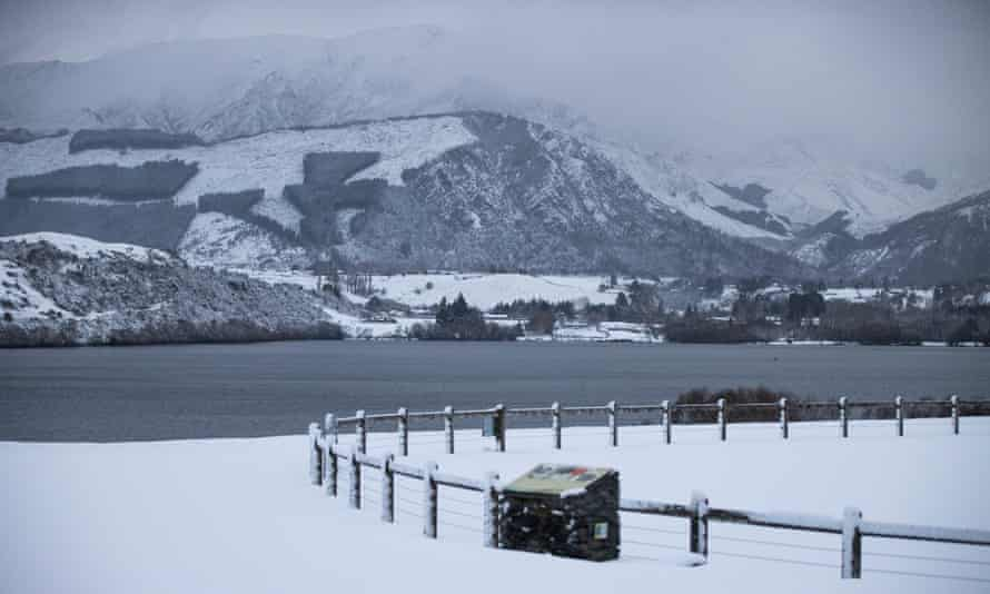 Snow falls in Lake Hayes in Wakatipu Basin, in New Zealand's South Island. The country has been hit by a winter storm that has closed roads and brought huge swells.
