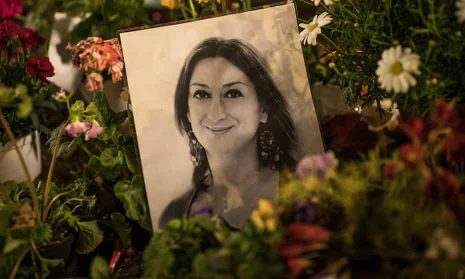 A photo of Daphne Caruana Galizia sits among floral tributes to the murdered journalist.