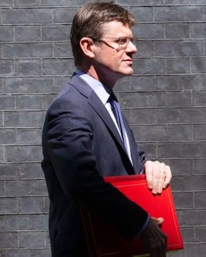 The business secretary Greg Clark, carrying a red portfolio