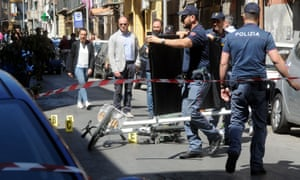 Italian police work on the site where mafia boss Giuseppe Dainotti, 67, was gunned down by two killers while riding his bike on Monday in Palermo, Sicily.