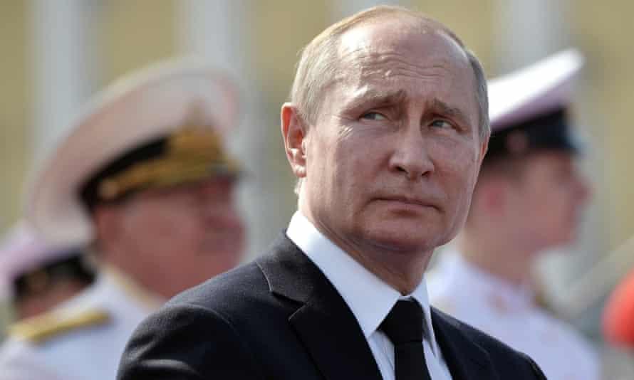 Vladimir Putin at a Navy Day parade in Saint Petersburg on Sunday.