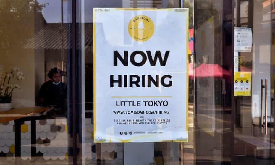 A 'Now Hiring' sign is posted in front of an ice-cream shop in Los Angeles, California in May 2021.