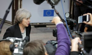 Theresa May speaking to the press