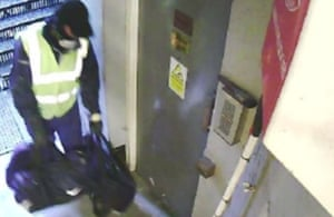 A still image taken from CCTV footage showing one of the burglars carrying tools in the fire escape corridor