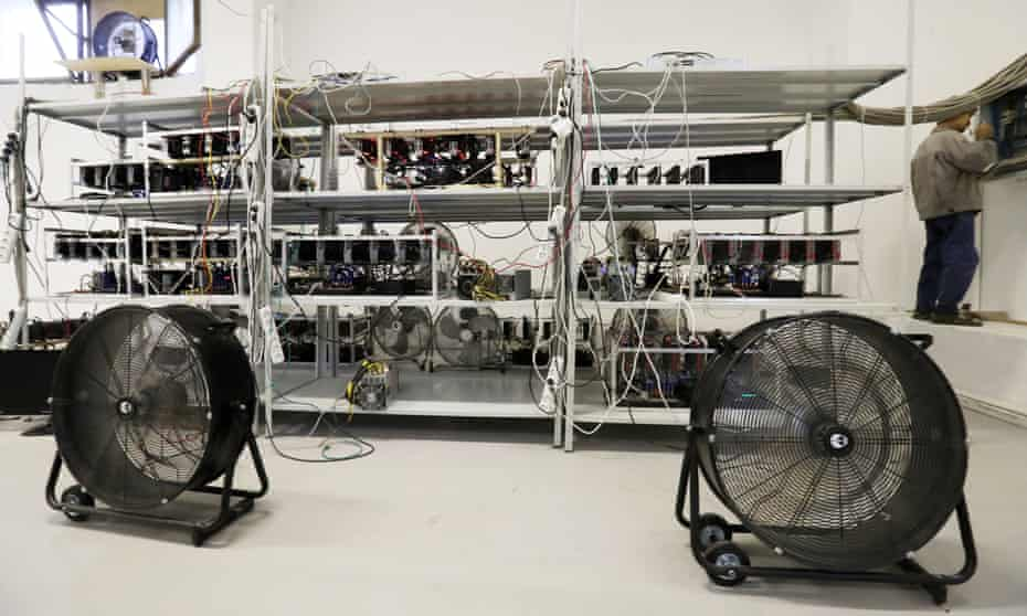 Computer equipment and cooling fans a bitcoin mining facility.