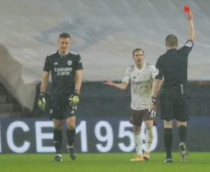 Bernd Leno goalkeeper of Arsenal walks is shown a red card by referee Craig Pawson.
