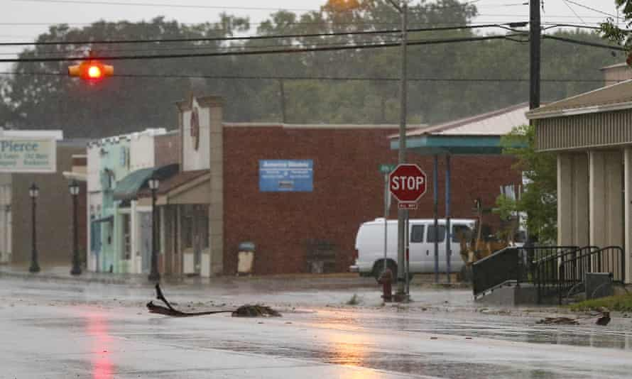 Debris from palm trees blow down the street as winds pick up as Tropical Storm Nicholas approaches Texas