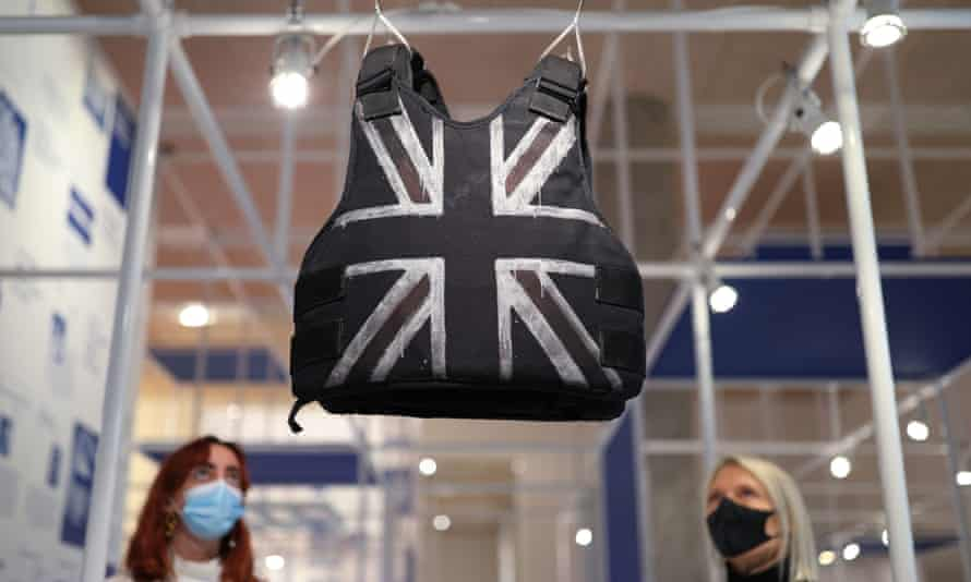 A customised stab-proof vest designed by Banksy and worn by Stormzy hangs in the Design Museum in London.