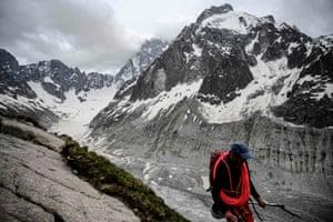 A climber walks near the Mer de Glace glacier