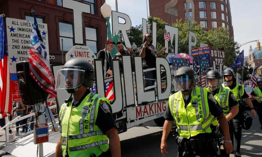 Police protect the straight pride parade in Boston.