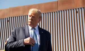 Donald Trump visits the US-Mexico border fence in Otay Mesa, California, on 18 September.